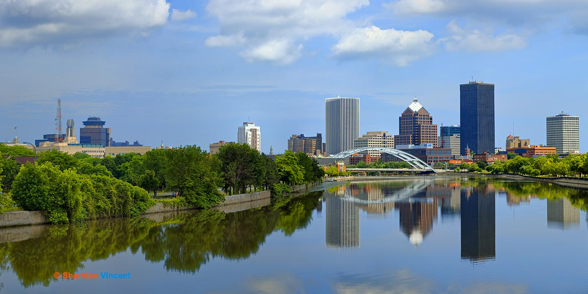 Genesee Skyline Reflection (Crop) by Sheridan Vincent